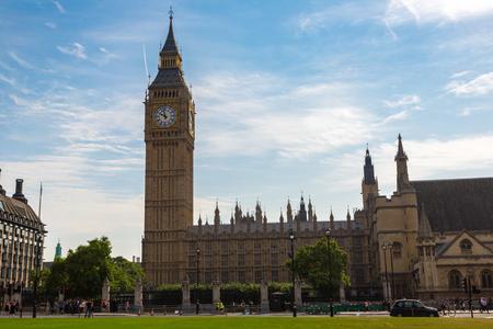 LONDON, UNITED KINGDOM - JUNE 14, 2016: Traffic near Parliament, Westminster Abbey and Big Ben, London, United Kingdom on June 14, 2016