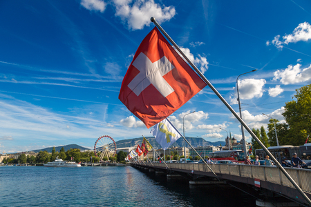 GENEVA, SWITZERLAND - JULY 25, 2017: Ferris wheel in Geneva in a beautiful summer day, Switzerland Editorial