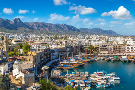 Panoramic aerial view of historic harbour in Kyrenia (Girne), North Cyprus in a beautiful summer day Фото со стока - 89474176