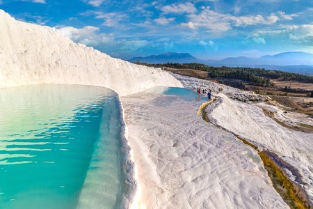 Travertine pools and terraces in Pamukkale, Turkey in a beautiful summer day