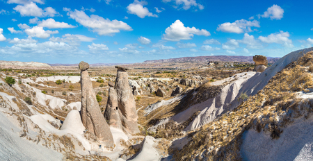 Three Graces (Three Beautifuls) rock hills in Devrent valley in Cappadocia, Nevsehir, Turkey in a beautiful summer day