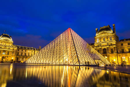 PARIS, FRANCE - JULY 14, 2017: The Louvre at night is one of the worlds largest museums  in Paris in a summer night