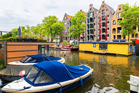 Canals of Amsterdam, Netherlands in a summer day Editorial