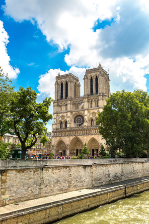 Seine and Notre Dame de Paris is the one of the most famous symbols of Paris in a summer day 写真素材