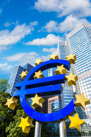 FRANKFURT, GERMANY - JULY 9, 2017: Euro sign. European Central Bank headquarters in Frankfurt in Germany  in a summer day