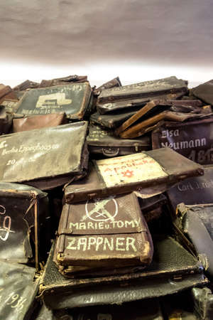 OSWIECIM, POLAND - JULY 22, 2014: Bags of victims in Auschwitz. It is the biggest nazi concentration camp on July 22, 2014 in Oswiecim, Poland Editorial
