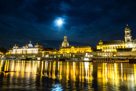 Panoramic view of Dresden in night and the river Elbe. Editorial