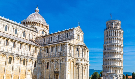 Leaning tower and Pisa cathedral in a summer day in Pisa, Italy