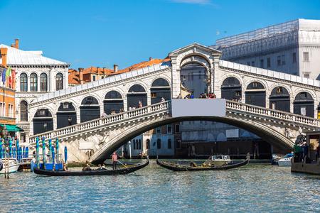 Gondola at the Rialto bridge in Venice, in a beautiful summer day in Italy Editorial