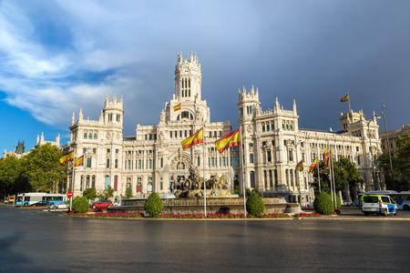 Cibeles Palace and Cibeles fountain at Plaza de Cibeles in Madrid in a beautiful summer day, Spain