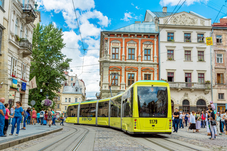 LVIV, UKRAINE - JULY 22, 2014: Modern Electronic tram Electron  in a summer day in the historic center of Lviv.