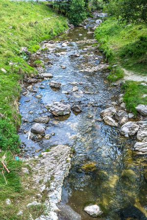 Small mountain river in a summer day in Transylvania, Romania