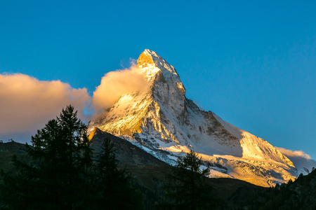 Sunset over mountain Matterhorn in Swiss Alps, Switzerland in a summer morning