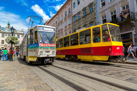 LVIV, UKRAINE - JULY 27, 2014: Old  tram is in the historic center of Lviv on  the Market Square in a summer day Editorial