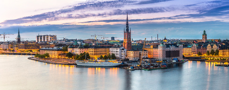 Panoramic view of Old Town (Gamla Stan) in Stockholm, Sweden in a summer night Banco de Imagens