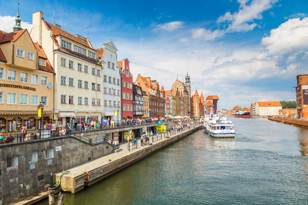 GDANSK, POLAND - JUNE 9, 2017: Tourist ship and colourful houses on Motlawa river in port of Gdansk, Baltic Sea, Poland in a summer day on 9 June 2017 Editorial