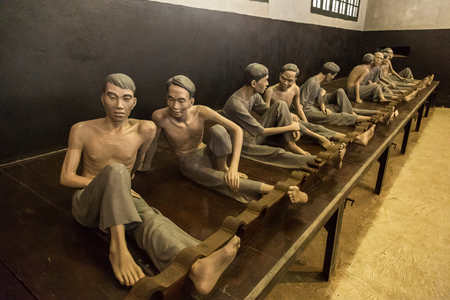 HANOI, VIETNAM - JUNE 7, 2018: Memorial jail interior with Models prisoners sculptures in Hoa Lo Prison in Hanoi, Vietnam in a summer day