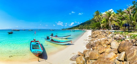 Panorama of Traditional wooden fisherman boat on Koh Phangan island, Thailand in a summer day Publikacyjne