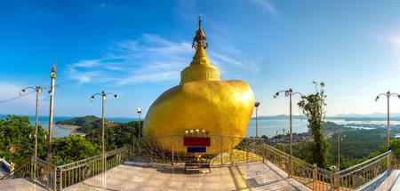 Replica of Phra That in Kwaen (Golden Rock) in Wat Koh Sirey temple in Phuket in Thailand in a summer day