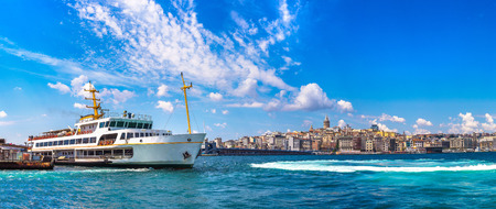Panorama of Passenger ship  and Galata Tower and Gulf of the Golden Horn in Istanbul, Turkey in a summer day