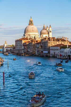 VENICE, ITALY - JUNE 18, 2014: Basilica Santa Maria della Salute and Grand Canal in Venice in a beautiful summer day in Italy on June 18 Redakční
