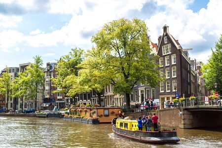 AMSTERDAM, NETHERLANDS - AUGUST 19, 2014: Canals of Amsterdam. Amsterdam is the capital and most populous city of the Netherlands Editorial