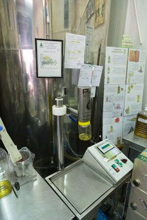 LOUTRAKI, GREECE - JULY 19, 2015: Small olive oil factory, Olive production in small greek town Editorial