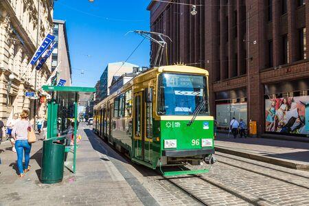 HELSINKI, FINLAND - JUNE 23, 2016: Public transport, retro tram in Helsinki in a beautiful summer day, Finland Editorial
