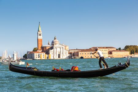 VENICE, ITALY - JUNE 18, 2014: Gondola on Canal Grande in Venice, in a beautiful summer day in Italy on June 18 Publikacyjne