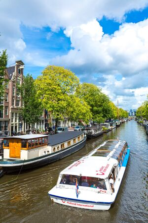 AMSTERDAM, NETHERLANDS - AUGUST 19, 2014: Canals of Amsterdam. Amsterdam is the capital and most populous city of the Netherlands