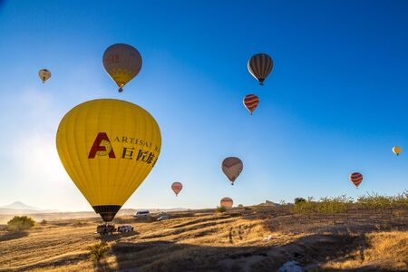 CAPPADOCIA, TURKEY - JULY 29, 2017: Hot air Balloons flight in Cappadocia, Nevsehir, Turkey in a beautiful summer day Editorial