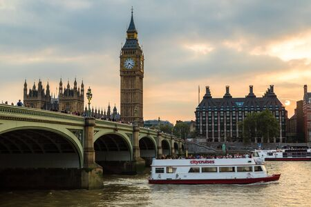 LONDON, UNITED KINGDOM - JUNE 14, 2016: The Big Ben, the Houses of Parliament and Westminster bridge in London in a beautiful summer night, England, United Kingdom Sajtókép