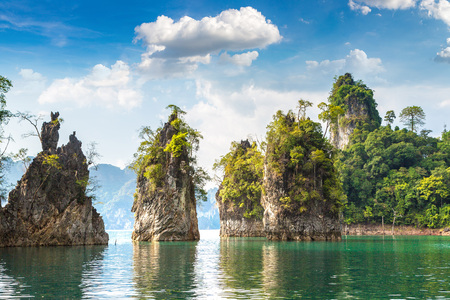 Limenstone rocks at Cheow Lan lake, Ratchaprapha Dam, Khao Sok National Park in Thailand in a summer day