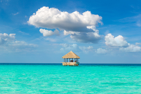 MALDIVES - JUNE 24, 2018: Water Villas (Bungalows) and wooden bridge at Tropical beach in the Maldives at summer day Editorial