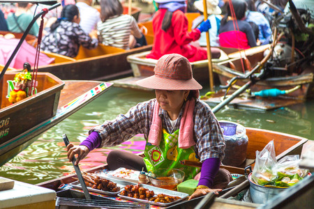 BANGKOK, THAILAND - MARCH 22, 2018: Floating market in Thailand in a summer day Editorial