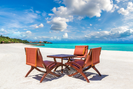 MALDIVES - JUNE 24, 2018: Table and chairs at tropical beach restaurant in the Maldives at summer day