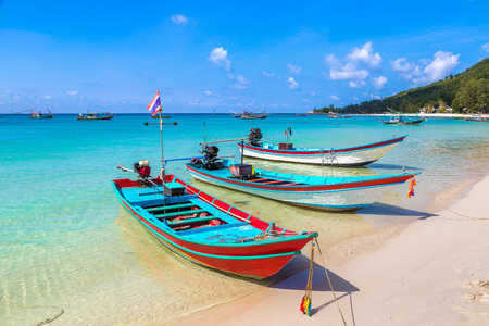 Traditional wooden fisherman boat on Koh Phangan island, Thailand in a summer day