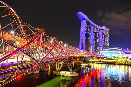 SINGAPORE - JUNE 23, 2018: Marina Bay Sands and Helix Bridge in Singapore at summer night