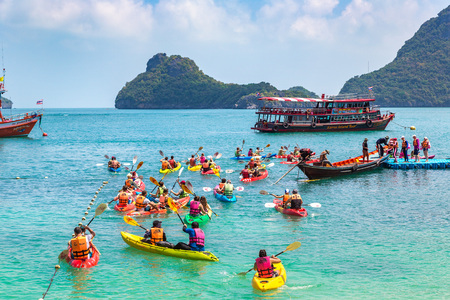 SAMUI, THAILAND - MARCH 29, 2018: Group of tourists on a kayak at Mu Ko Ang Thong National Park, Thailand in a summer day