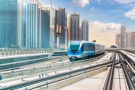 Dubai metro railway in a summer day in Dubai, United Arab Emirates Фото со стока
