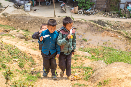 SAPA, VIETNAM - JUNE 19, 2018: Ethnic minority children in Sapa, Lao Cai, Vietnam in a summer day