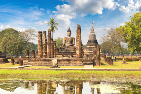 Wat Mahathat Temple in Sukhothai historical park, Thailand in a summer day