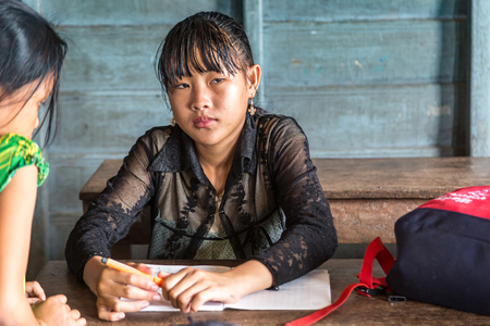 CHONG KHNEAS, CAMBODIA - JUNE 11, 2018: Cambodian students in floating school in Chong Khneas floating village near Siem Reap, Cambodia
