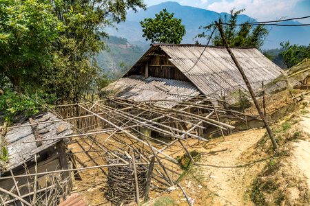 SAPA, VIETNAM - JUNE 19, 2018: Old wooden farm house in Sapa, Lao Cai, Vietnam in a summer day