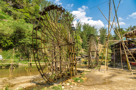 Water mill in Cat Cat village near Sapa, Lao Cai, Vietnam in a summer day