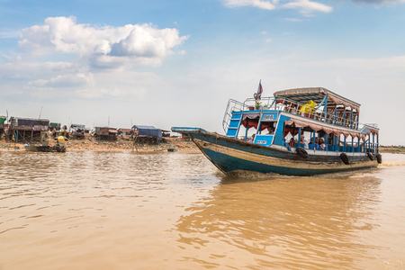 CHONG KHNEAS, CAMBODIA - JUNE 11, 2018: Chong Khneas floating village near Siem Reap, Cambodia in a summer day
