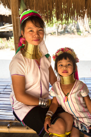 CHIANG RAI, THAILAND - MARCH 29, 2018: Portrait of a long neck woman in village near Chiang Rai, Thailand in a summer day Redakční