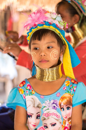 CHIANG RAI, THAILAND - MARCH 29, 2018: Portrait of a long neck little girl in a village near Chiang Rai, Thailand in a summer day Redakční