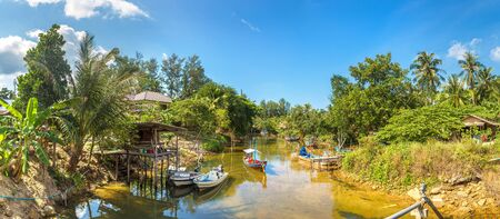 Panorama of Traditional wooden fisherman boat on Koh Phangan island, Thailand in a summer day
