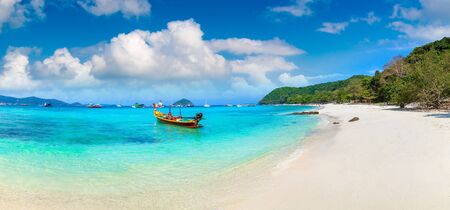 Panorama of Traditional long tail boat on Coral (Ko He) island near Phuket island, Thailand in a summer day